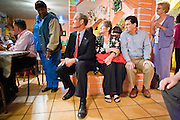 """13 OCTOBER 2010 - SOUTH TUCSON, AZ: Terry Goddard sits on bench next to Betsy Bolding and Augie Garcia during a Democratic """"Unity Rally"""" at Rigo's in South Tucson. Goddard spent the day in Tucson campaigning. Goddard lost the election to sitting Governor Jan Brewer, a conservative Republican.     PHOTO BY JACK KURTZ"""