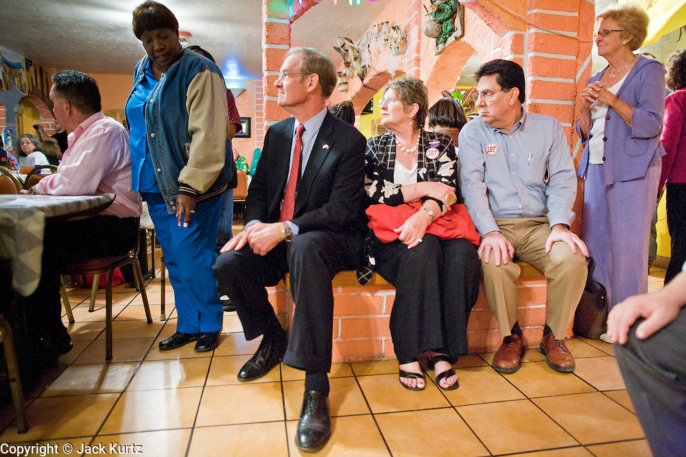 "13 OCTOBER 2010 - SOUTH TUCSON, AZ: Terry Goddard sits on bench next to Betsy Bolding and Augie Garcia during a Democratic ""Unity Rally"" at Rigo's in South Tucson. Goddard spent the day in Tucson campaigning. Goddard lost the election to sitting Governor Jan Brewer, a conservative Republican.     PHOTO BY JACK KURTZ"