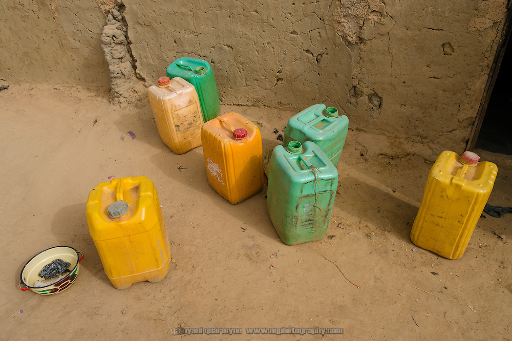 Water storage containers at the home of Marcel Kabore (51) in Zongo, an informal settlement in Burkina Faso's capital, Ouagadougou, on 24 February 2016.