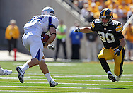 September 4 2010: Eastern Illinois Panthers tight end Cody Bruns (82) tries to avoid Iowa Hawkeyes cornerback Brett Greenwood (30) during the second quarter of the NCAA football game between the Eastern Illinois Panthers and the Iowa Hawkeyes at Kinnick Stadium in Iowa City, Iowa on Saturday September 4, 2010. Iowa defeated Eastern Illinois 37-7.