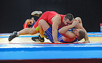 Igor DIDYK (ITA) in red v Johan EUREN (SWE) in blue, 120kg class, Greco Roman, The London Prepares Wrestling Olympic Test Event, ExCel Arena, London, England December 11, 2011.