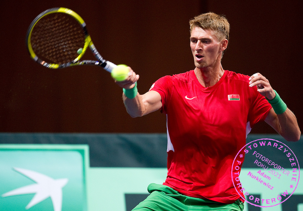Alexander Bury of Belarus competes at man's singles match at third day during the BNP Paribas Davis Cup 2012 between Poland and Belarus at MOSiR Hall in Lodz on September 16, 2012...Poland, Lodz, September 16, 2012..Picture also available in RAW (NEF) or TIFF format on special request...For editorial use only. Any commercial or promotional use requires permission...Photo by © Adam Nurkiewicz / Mediasport