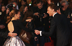 Israeli US actress Natalie Portman jokes with co-star Tom Hiddleston as they arrive for the World Premiere of their latest film Thor The Dark World.  in London's Leicester Square, England, United Kingdom. Tuesday, 22nd October 2013. Picture by Max Nash / i-Images
