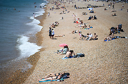 © Licensed to London News Pictures. 03/07/2018. Brighton, UK. Members of the public enjoy the continued hot weather on the seafront At Brighton on the south coast of England. Photo credit: Ben Cawthra/LNP
