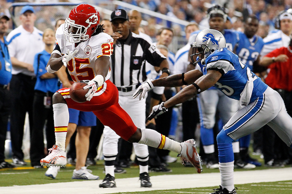 Kansas City Chiefs running back Jamaal Charles (25) reaches the ball forward to try and get a first down as Detroit Lions defensive back Brandon McDonald (33) forces him out of bounds in the first quarter of an NFL football game in Detroit, Sunday, Sept. 18, 2011. Jamaal Charles was injured on the play. (AP Photo/Rick Osentoski)
