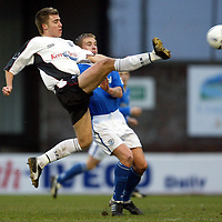 Ayr Utd v St Johnstone...13.12.03<br />Aaron Black clears from Ryan Stevenson<br /><br />Picture by Graeme Hart.<br />Copyright Perthshire Picture Agency<br />Tel: 01738 623350  Mobile: 07990 594431