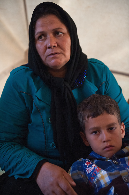 An Afghan woman with her grandson inside their tent in Kara Tepe camp. She came here with her 3 daughters and their children and the don't have money to pay the boat ticket to go to mainland Greece.