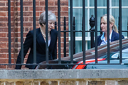 © Licensed to London News Pictures. 19/07/2018. London, UK. Prime Minister Theresa May (L) leaves 10 Downing Street. Photo credit: Rob Pinney/LNP