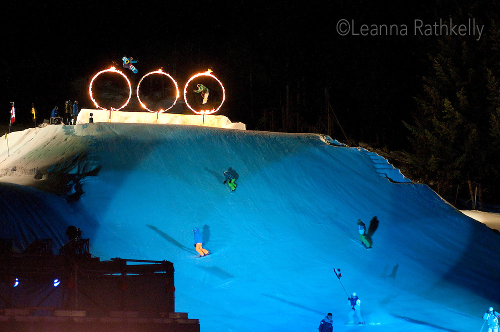 Skiers and Snowboarders jump through fiery hoops during the Fire and Ice night ski and snowboard show at Whistler Village, Whistler, BC
