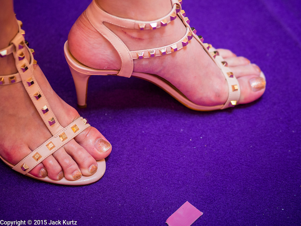 25 MARCH 2015 - BANGKOK, THAILAND: A contestants shoes during the first round of the Miss Tiffany's contest at CentralWorld, a large shopping mall in Bangkok. Miss Tiffany's Universe is a beauty contest for transgender contestants; all of the contestants were born biologically male. The final round will be held on May 8 in the beach resort of Pattaya. The final round is televised of the  Miss Tiffany's Universe contest is broadcast live on Thai television with an average of 15 million viewers.     PHOTO BY JACK KURTZ