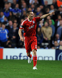 Fabio Aurellio celebrates scoring  the opening goal for Liverpool during the UEFA Champions League Quarter Final Second Leg match between Chelsea and Liverpool at Stamford Bridge on April 14, 2009 in London, England.