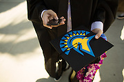 San Jose State students celebrate during the Economics convocaton at San José State University's Music Concert Hall in San Jose, California, on May 23, 2013. (Stan Olszewski/SOSKIphoto)