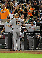 June 14 2011; Phoenix, AZ, USA; San Francisco Giants base runner Aubrey Huff (17) is congratulated by manager Bruce Bochy  after scoring during the fifth inning against the Arizona Diamondbacks at Chase Field. Mandatory Credit: Jennifer Stewart-US PRESSWIRE..