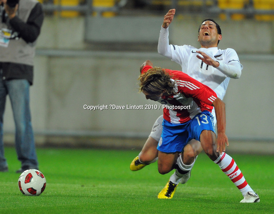 Leo Bertos is tackled by Paraguay's Enrique Vera. International football friendly - New Zealand All Whites v Paraguay at Westpac Stadium, Wellington on Tuesday, 12 October 2010. Photo: Dave Lintott / photosport.co.nz