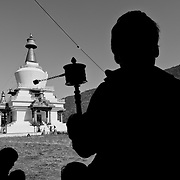 Bhutanese man holding a prayer wheel at Memorial Chorten, Thimphu, Bhutan, Asia