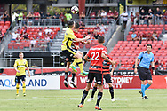 February 12, 2017: Central Coast Mariners forward Roy O'DONOVAN (9) goes up for the ball with Western Sydney Wanderers midfielder Kearyn BACCUS (15) at Round 19 of the 2017 Hyundai A-League match, between Western Sydney Wanderers and Central Coast Mariners played at Spotless Stadium in Sydney.