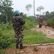 Peacekeeper and population in the base of Biankatu village, Ituri region.