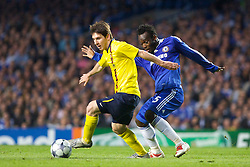 LONDON, ENGLAND - Wednesday, May 6, 2009: Chelsea's Michael Essien and Barcelona's Lionel Messi during the UEFA Champions League Semi-Final 2nd Leg match at Stamford Bridge. (Photo by Carlo Baroncini/Propaganda)