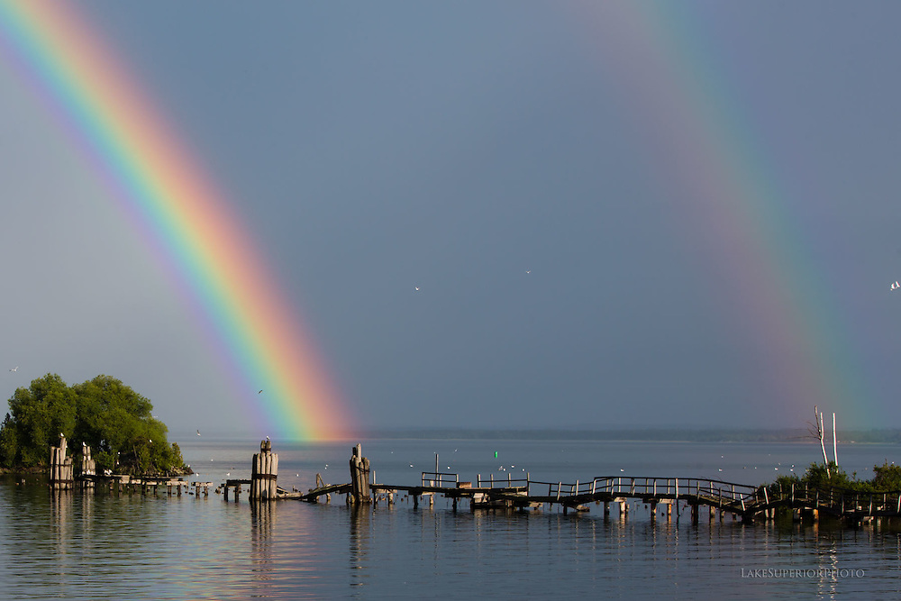 bright rainbow over Marquette MI lower harbor Lake Superior