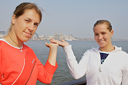 Liverpool, England - Sunday, June 10, 2007: Olga Savchuk (L) and Ashley Harkleroad (R) hold the city in their hands on the deck of the Royal Daffodil Mersey Ferry as they take a cruise along Liverpool's famous River Mersey. The WTA tennis players are in the city for the Liverpool International Tennis Tournament which starts on Tuesday June 12th. For more information please visit www.liverpooltennis.co.uk. (Pic by David Rawcliffe/Propaganda)