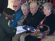 A flag is presented to Helen White during the funeral for first cousin Army Pfc. Weldon Alonzo Davis, a Korean War soldier who died as a POW in 1951, at the Dallas-Fort Worth National Cemetery on Wednesday, February 6, 2013 in Dallas, Texas. (Cooper Neill/The Dallas Morning News)