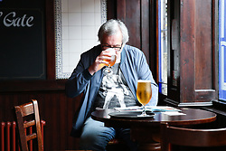 © Licensed to London News Pictures. 04/07/2020. London, UK. A man has a drink at THE TOLL GATE,  a Wetherspoon pub in north London which reopened on Super Saturday. Cafes, restaurants, pubs and hairdressers across the UK closed on 23 March following the coronavirus lockdown. As restrictions are eased, cafes, restaurants, pubs and hairdressers reopens today. Photo credit: Dinendra Haria/LNP