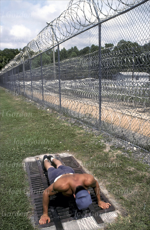 Medium security prison - Push-ups exercise yard Caucasian inmate working out - Putnam County, FL  detainees