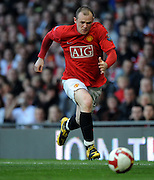 Wayne Rooney runs with the ball for Manchester United during the Premier League match between Manchester United and Tottenham Hotspur at Old Trafford, Manchester, England, 25th April 2009