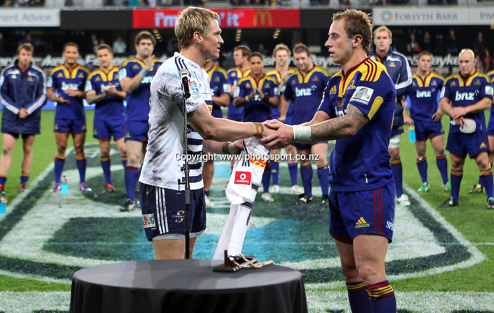 Jean de Villers pays tribute to Jimmy Cowan's 100th match for the Highlanders by presenting a Stormers No.9 jersey.<br /> Investec Super Rugby - Highlanders v Stormers, 7 April 2012, Forsyth Barr Stadium, Dunedin, New Zealand.<br /> Photo: Rob Jefferies / photosport.co.nz