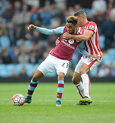 Jordan Amavi of Aston Villa battles for the ball with Mame Biram Diouf of Stoke City - Mandatory byline: Alex James/JMP - 07966 386802 - 03/10/2015 - FOOTBALL - Villa Park - Birmingham, England - Aston Villa v Stoke City - Barclays Premier League