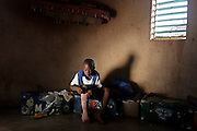 Sylvain Longo, age 15 gets ready to go to a football tournament organised by Coaching for Hope. Sylvain shares his hut with 7 other boys at the AMPO orphanage in Burkina Faso. Coaching for Hope is a project to raise awareness of HIV and AIDS through football.