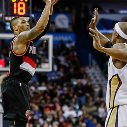 Mar 14, 2017; New Orleans, LA, USA; Portland Trail Blazers guard Damian Lillard (0) shoots over New Orleans Pelicans forward Dante Cunningham (33) during the second half of a game at the Smoothie King Center. The Pelicans defeated the Trail Blazers 100-77. Mandatory Credit: Derick E. Hingle-USA TODAY Sports