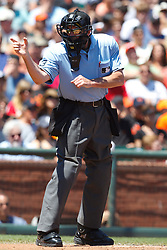 August 6, 2011; San Francisco, CA, USA;  MLB umpire Mike Winters (33) calls a strike during the second inning between the San Francisco Giants and the Philadelphia Phillies at AT&T Park. Philadelphia defeated San Francisco 2-1.