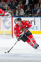 KELOWNA, CANADA - MAY 1: Miles Koules #12 of Portland Winterhawks skates with the puck against the Kelowna Rockets on May 1, 2015 at Prospera Place in Kelowna, British Columbia, Canada.  (Photo by Marissa Baecker/Getty Images)  *** Local Caption *** Miles Koules;