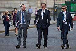 © licensed to London News Pictures. London, UK 04/09/2013. Prime Minister David Cameron walking to Parliament in Westminster, London on Wednesday, September 4, 2013. Photo credit: Tolga Akmen/LNP