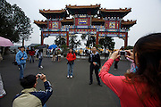 Imperial Summer Palace (Yihe Yuan). Kunming lake. Yunhuiyuyu Archway. Tourists taking souvenir photos with digicams.