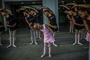 Melissa Barboza  joins older colleagues as they are taught ballet outside a public library in Manguinhos neighbourhood, Rio de Janeiro, Brazil, Monday, June 11, 2018. The Manguinhos community ballet has been a reprieve from the violence and poverty that afflicts its namesake neighborhood for hundreds of girls who have benefitted from free dance classes since 2012. (Dado Galdieri for The New York Times)