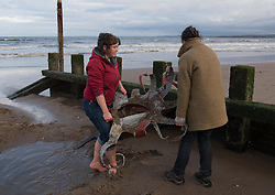Last night storm Angus swept away Cressida, the Portobello tidal octopus. Fortunately she didn't swim too far and this afternoon when the tide retreated the artist, Lauren Fox, and a few others rescued her from the sand before the tide swept in again.<br /> © Jon Davey/ EEm
