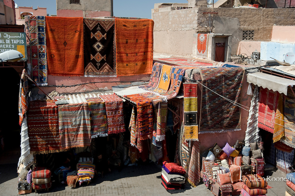 Colourful wool carpets hanging in the souk in Marrakech,  Morocco