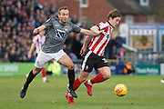 Coventry City Midfielder Liam Kelly battling with Lincoln City Midfielder Alex Woodyard during the EFL Sky Bet League 2 match between Lincoln City and Coventry City at Sincil Bank, Lincoln, United Kingdom on 18 November 2017. Photo by Craig Zadoroznyj.