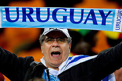 Fans of Uruguay celebrate after penalty shots at the 2010 FIFA World Cup South Africa Quarter Finals football match between Uruguay and Ghana on July 02, 2010 at Soccer City Stadium in Sowetto, suburb of Johannesburg. (Photo by Vid Ponikvar / Sportida)