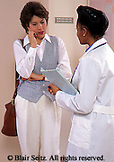 Medical, Doctor, Physician at Work, Physician and Mother or Guardian, Doctor Discusses Care