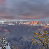 Last bit of sunset light shines on clouds and cliffs. Grand Canyon National park, AZ