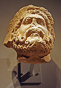 Limestone Head of a Bearded Man, Possibly Jupiter.  South Italian, possibly Apolia.  Carved 1200-1300.