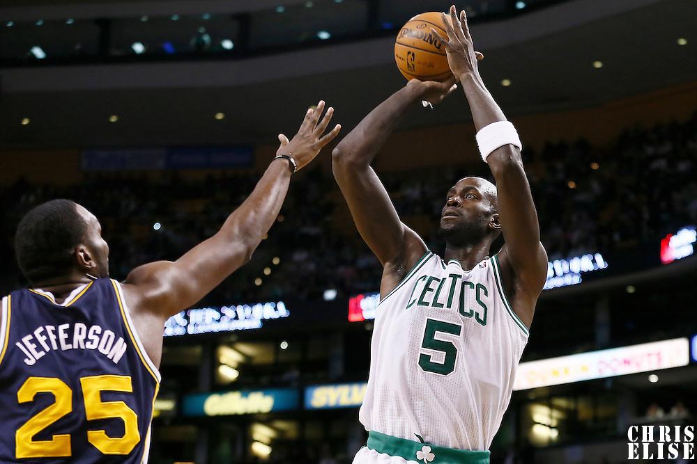 14 November 2012: Boston Celtics power forward Kevin Garnett (5) takes a jumpshot over Utah Jazz center Al Jefferson (25) during the Boston Celtics 98-93 victory over the Utah Jazz at the TD Garden, Boston, Massachusetts, USA.