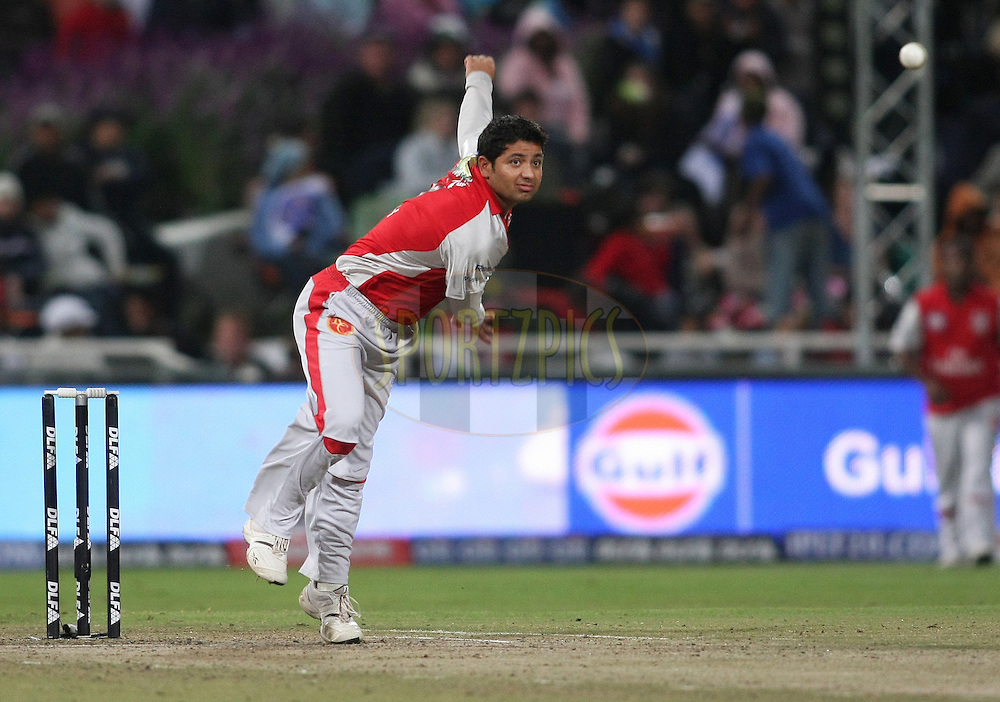 CAPE TOWN, SOUTH AFRICA - 26 April 2009. Piyush Chawla bowls during the IPL Season 2 match between TheKings X1 Punjab and Rajasthan Royals held at Sahara Park Newlands in Cape Town, South Africa..