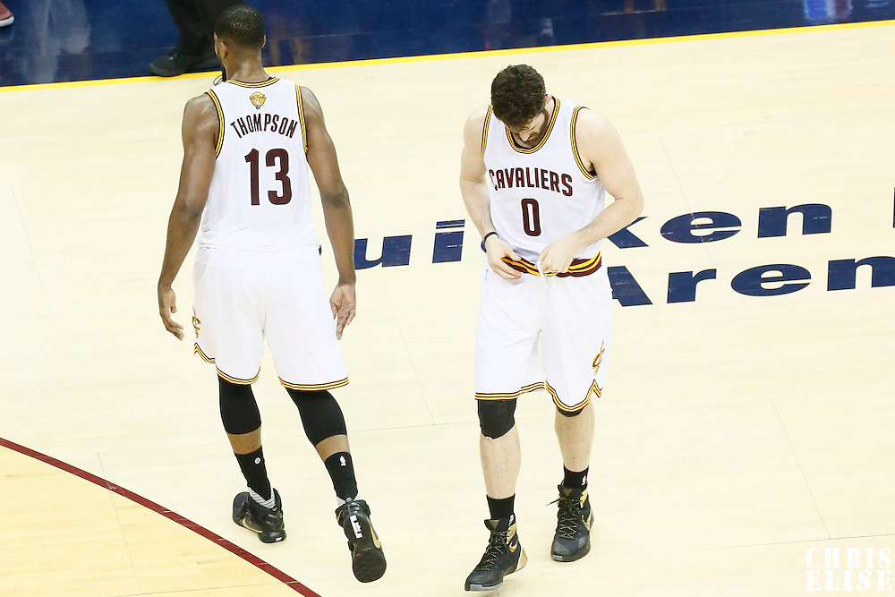 10 June 2016: Cleveland Cavaliers center Tristan Thompson (13) is seen next to Cleveland Cavaliers forward Kevin Love (0) during the Golden State Warriors 108-97 victory over the Cleveland Cavaliers, during Game Four of the 2016 NBA Finals at the Quicken Loans Arena, Cleveland, Ohio, USA.