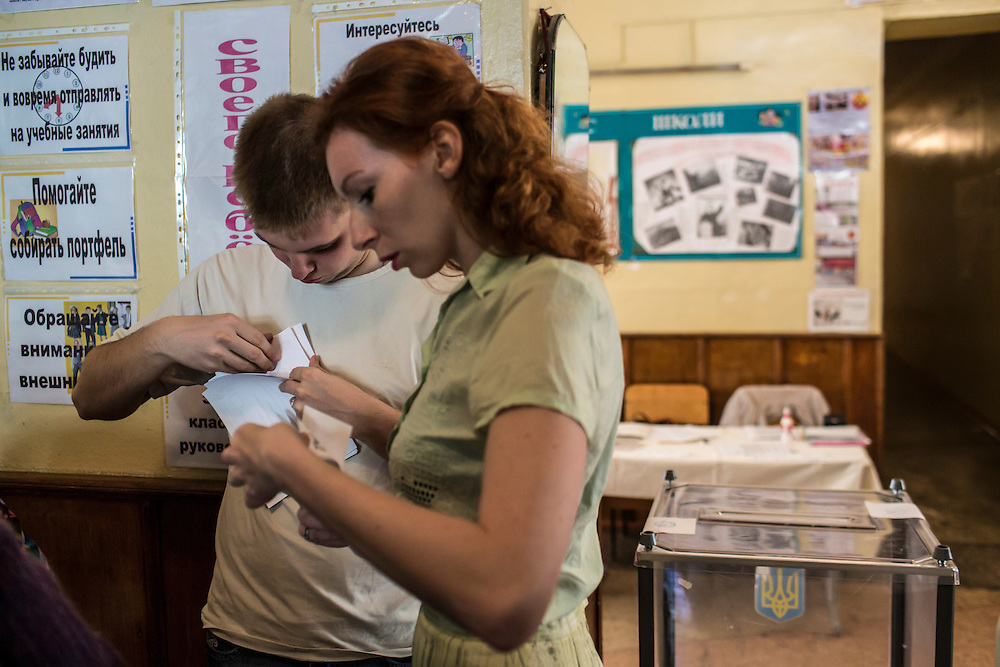 DONETSK, UKRAINE - MAY 11: Workers prepare for a polling station to open on May 11, 2014 in Donetsk, Ukraine. A referendum on greater autonomy is being held after pro-Russian activists took over at least ten cities in the eastern part of the country in a bid for less control from the central government from Kiev. (Photo by Brendan Hoffman/Getty Images) *** Local Caption ***