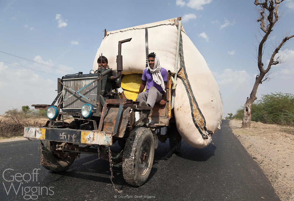 Overloaded Indian Jugaad in rural Madhya Pradesh. For safety reasons these improvised vehicles are officially banned by the government of India but have become popular as a means to transport in rural areas