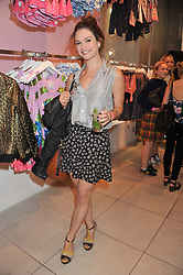 Actress LILY JAMES at a party to celebrate the launch of Louise Gray's make-up and clothing collections for Topshop held at Topshop Edited, 286 Regent Street, London on 22nd August 2012.